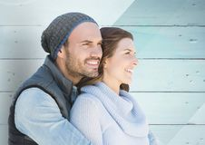 Romantic couple embracing each other against wooden background Royalty Free Stock Photos