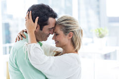 Romantic couple embracing at home Royalty Free Stock Images