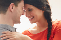 Romantic Couple Embracing Indoors. Laughing Stock Photos