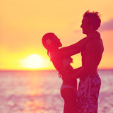Romantic couple embracing kissing on beach sunset Royalty Free Stock Photos