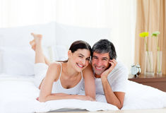 Romantic couple embracing lying on their bed Royalty Free Stock Photography