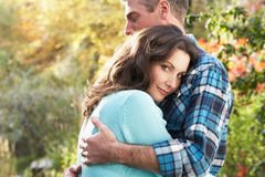 Romantic Couple Embracing By Woodland Stock Photography