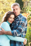Romantic Couple Embracing By Woodland. Romantic Couple Embracing By Autumn Woodland Stock Photography