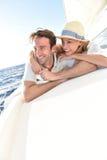 Romantic couple enjoying the cruise on the sailing boat Royalty Free Stock Photos