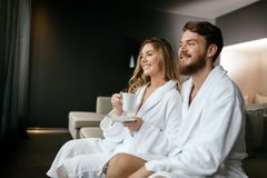 Romantic couple enjoying honeymoon escape. And wellness weekend Stock Photos