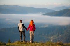 Romantic couple enjoying a morning haze over the mountains Royalty Free Stock Photo