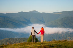 Romantic couple enjoying a morning haze over the mountains Royalty Free Stock Image