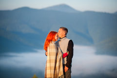 Romantic couple enjoying a morning haze over the mountains stock photography