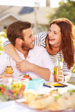 Romantic Couple Enjoying Outdoor Meal In Garden Stock Image