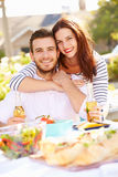 Romantic Couple Enjoying Outdoor Meal In Garden Stock Photography