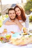 Romantic Couple Enjoying Outdoor Meal In Garden Stock Photography