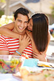 Romantic Couple Enjoying Outdoor Meal In Garden Royalty Free Stock Photo
