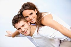 Romantic Couple Enjoying Their Summer Vacation. Portrait of a happy young couple enjoying their summer vacation,  on bright background Royalty Free Stock Photography