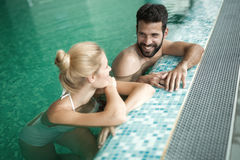 Romantic couple enjoying thermal bath. Spa and wellness center Stock Photos