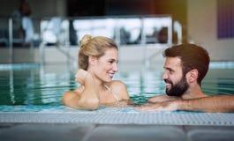 Romantic couple enjoying thermal bath. Spa and wellness center royalty free stock image