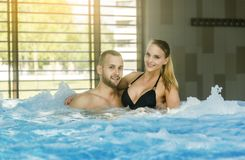 Romantic couple enjoying thermal bath spa and wellness center.  Royalty Free Stock Photography