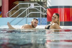 Romantic couple enjoying thermal bath spa and wellness center Royalty Free Stock Photography