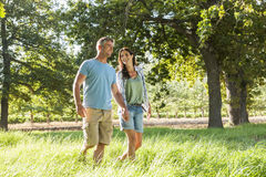 Romantic Couple Enjoying Walk In Beautiful Countryside Stock Photography