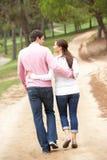 Romantic couple enjoying walk in park Stock Images