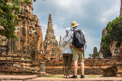 Romantic couple, European and Asian, embracing each other at old temple ruins royalty free stock photo