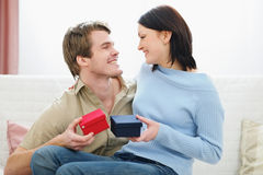 Romantic couple exchanging presents Stock Photos