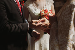 Romantic couple exchanging rings during wedding ceremony in chur Stock Images