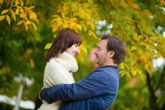Romantic couple on a fall day Stock Photography