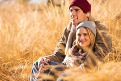 Romantic couple fall. Romantic young couple sitting outdoors in fall royalty free stock photos
