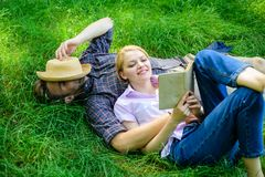 Romantic couple family enjoy leisure with poetry or literature grass background. Couple soulmates at romantic date. Couple in love spend leisure reading book royalty free stock photo