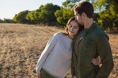 Romantic couple on field. Romantic young couple standing on field Stock Image