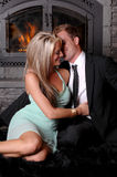 Romantic couple fireplace prepare Stock Images