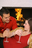 Romantic couple by fireplace vertical Royalty Free Stock Image