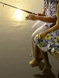 Romantic couple fishing. Photo of romantic couple fishing at the lake in the evening Royalty Free Stock Photo