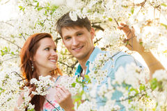 Romantic couple in flower garden royalty free stock photo