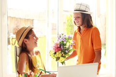 Romantic couple with flowers Royalty Free Stock Photos