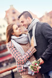 Romantic couple with flowers on a walk Royalty Free Stock Image