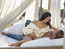 Romantic Couple In Four-Poster Bed Stock Photos