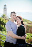 Romantic couple in front of a Lighthouse in California Stock Images