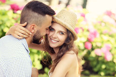 Romantic couple in the garden Stock Images