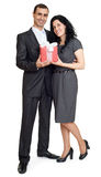 Romantic couple with gift box, people dressed in black suit, man gives gift to woman, isolated on white background Stock Images