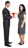 Romantic couple with gift box, people dressed in black suit, man gives gift to woman, isolated on white background Stock Photo
