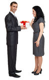 Romantic couple with gift box, people dressed in black suit, man gives gift to woman, isolated on white background Royalty Free Stock Photo