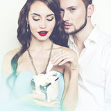 Romantic couple with gift Stock Photography