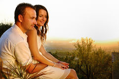 Romantic couple with girl sitting on guy at sunset Royalty Free Stock Images