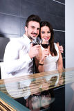 A romantic couple with a glass of wine in the dining room Royalty Free Stock Images