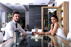 A romantic couple with a glass of wine in the dining room Stock Photo