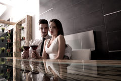 A romantic couple with a glass of wine Stock Photography