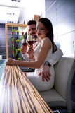 A romantic couple with a glass of wine in the dining room Royalty Free Stock Photos