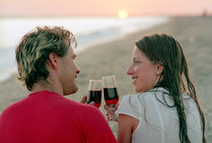 Romantic couple with goblet of wine on a beach Stock Photo