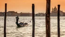 Romantic couple on gondola in the Grand Canal, Venice, Italy Stock Image